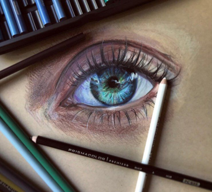 Colored pencils next to a drawing